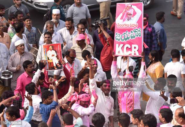 Telangana Rashtra Samithi supporters celebrate after the party's electoral win outside TRS Bhavan Banjara Hills on December 11 2018 in Hyderabad...
