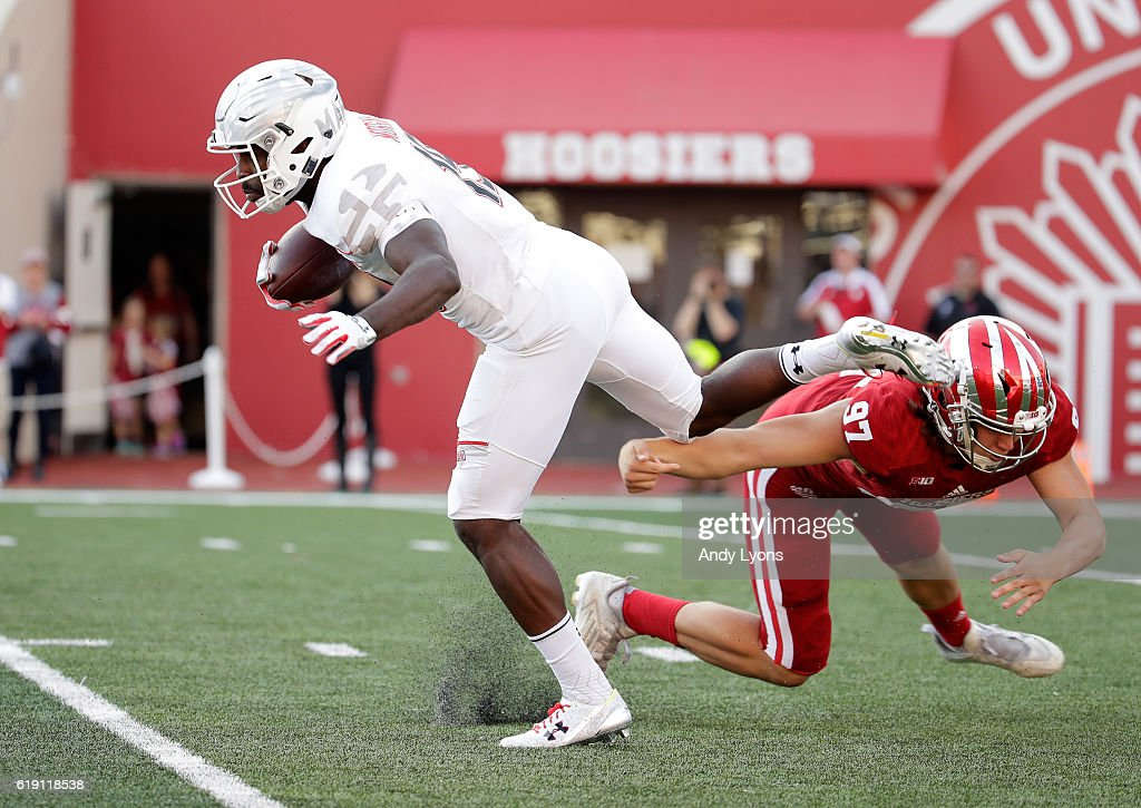 Teldrick Morgan #19 of the Maryland Terrapins returns a punt while defended by Dan Godsil#97 of the Indiana Hoosiers at Memorial Stadium on October 29, 2016 in Bloomington, Indiana.