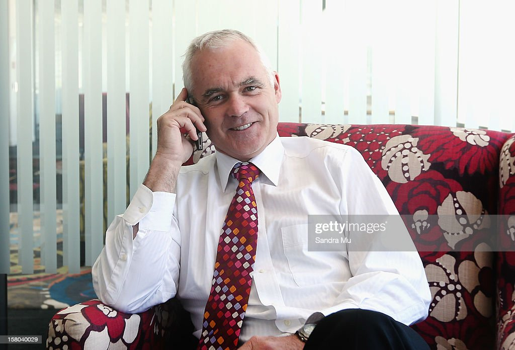 Telecom CEO Simon Moutter poses on his mobile at Telecom Place on December 10, 2012 in Auckland, New Zealand. Today Telecom announced a breakthrough new approach to international data roaming that will see smartphone and other mobile device costs slashed for overseas travellers.