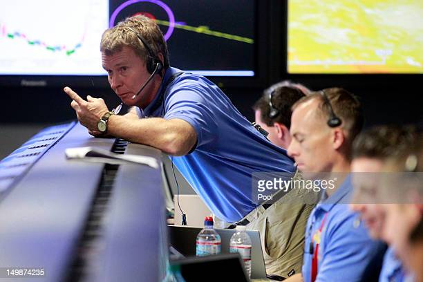 Telecom engineer Peter Ilott talks inside the Spaceflight Operations Facility for NASA's Mars Science Laboratory Curiosity rover at Jet Propulsion...