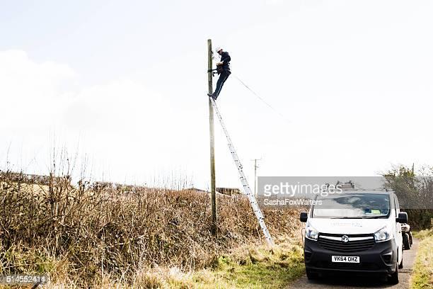 telecom engineer repairing telephone line
