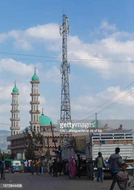 Telecommunication antenna in front of a mosque Oromia Karamile Ethiopia on November 3 2018 in Karamile Ethiopia