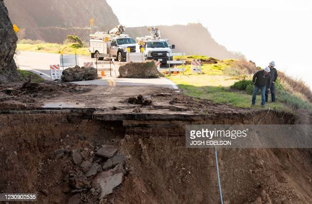 Telecommunication crews survey the scene where a section of Highway 1 collapsed into the Pacific Ocean near Big Sur, California on January 31, 2021....