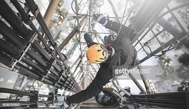 Telecommunication manual high worker engineer repairing antenna