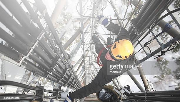 Telecommunication manual high worker engineer repairing antenna
