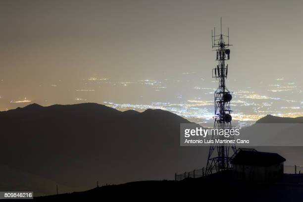 telecommunication tower at night - communications tower stock pictures, royalty-free photos & images