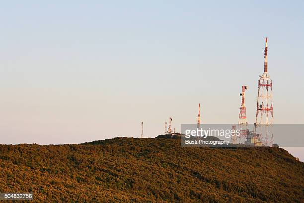 Telecommunication towers on top of a hill, Italy