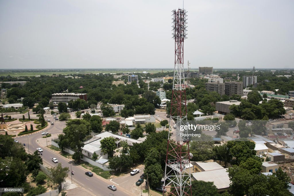 A telecommunications mast stands among residential buildings in N'Djamena, Chad, on Wednesday, Aug. 16, 2017. African Development Bank and nations signed agreement to finance a project linking the town of Ngouandere in Cameroon and Chads capital, NDjamena, according to statement handed to reporters in Cameroonian capital, Yaounde in July. Photographer: Xaume Olleros/Bloomberg via Getty Images