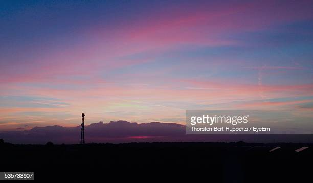 Telecommunications Tower Against Dramatic Sky