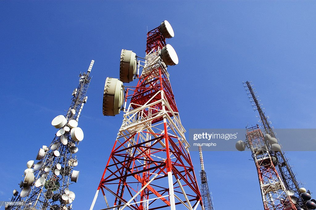 Telecommunications Tower, blu skye with clouds : Stock Photo