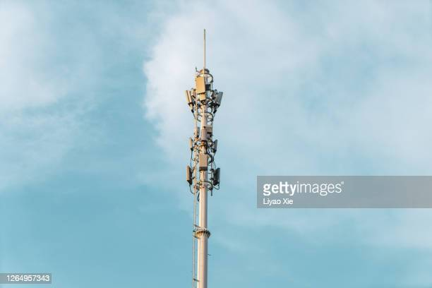 telecommunications tower with antennas on blue sky with cloud - liyao xie stock pictures, royalty-free photos & images