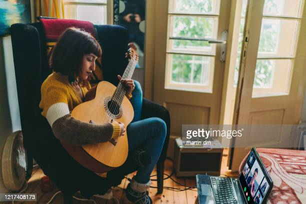 teleconferencing with music, covid-19 pandemic - guitar stock pictures, royalty-free photos & images