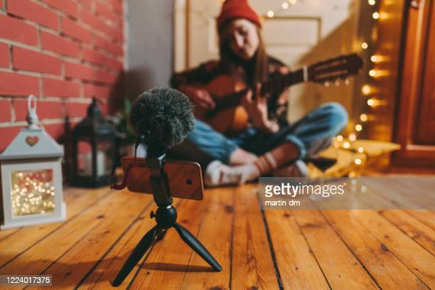 teleconferencing with music - musician stock pictures, royalty-free photos & images