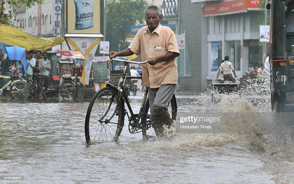 Telegram Delivery man Rambabu wades through knee deep waters to deliver the last bundle of telegrams in his pocket from General Post Office on July 14, 2013 in Jaipur, India. The work to lay telegraph lines started in 1850 on an experimental basis between Koklata and Diamond Harbour, it was opened for use by the British East India Company the following year. In 1854, the service was made available to the public. 163-year-old telegram service is being shut down by the Government from 15th of July, across the country.