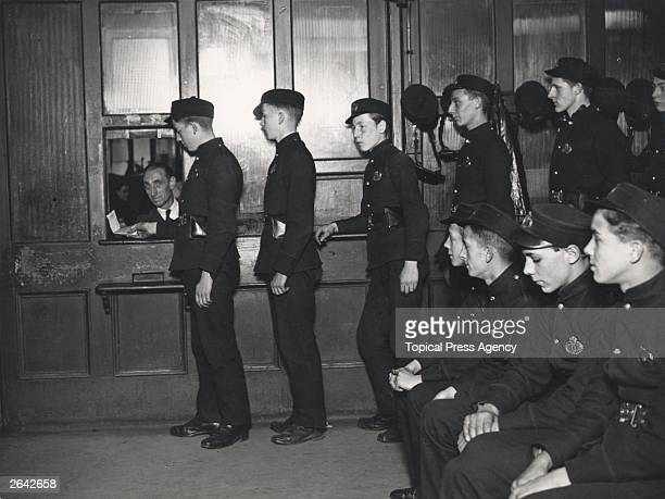 Telegraph boys line up to receive telegrams for delivery at the Central Telegraph Office GPO in London where 50000 telegrams are processed every year