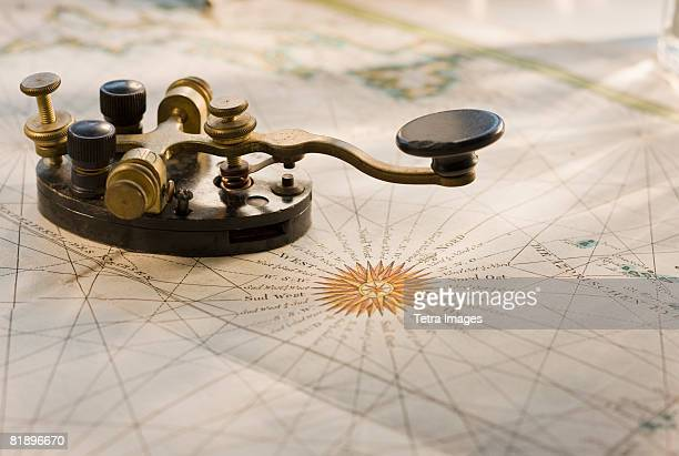Telegraph key on antique map