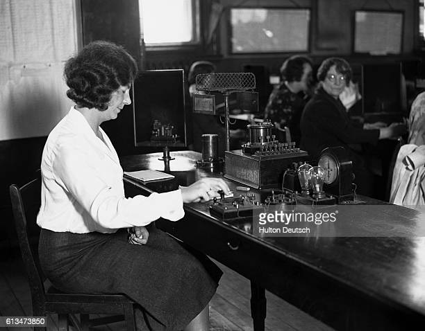 A telegraph operator sending a message using the Morse code system by hand This was later replaced by the teletype machine