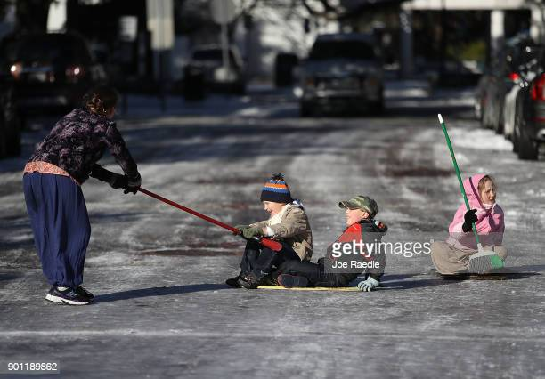 Telem Fenster Jediah Pendergrass Shebuel Fenster and Keren Fenster play on an icy street on January 4 2018 in Savannah Georgia From Maine to Florida...
