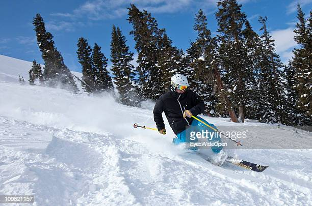 Telemark skier in action in powder snow at Kat which offers Cat skiing on February 04 2011 in Keystone near Vail Colorado United States Untouched...