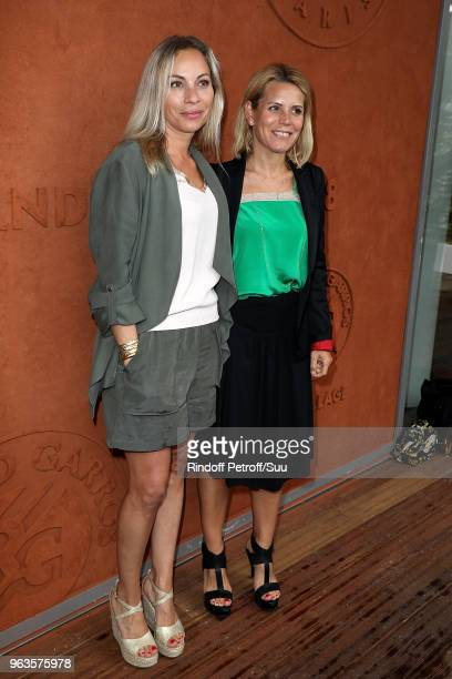Telematin Tv host Charlotte Bouteloup and Laura Tenoudji attend the 2018 French Open - Day Three at Roland Garros on May 29, 2018 in Paris, France.