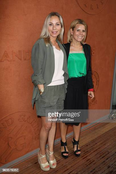 Telematin Tv host Charlotte Bouteloup and Laura Tenoudji attend the 2018 French Open Day Three at Roland Garros on May 29 2018 in Paris France