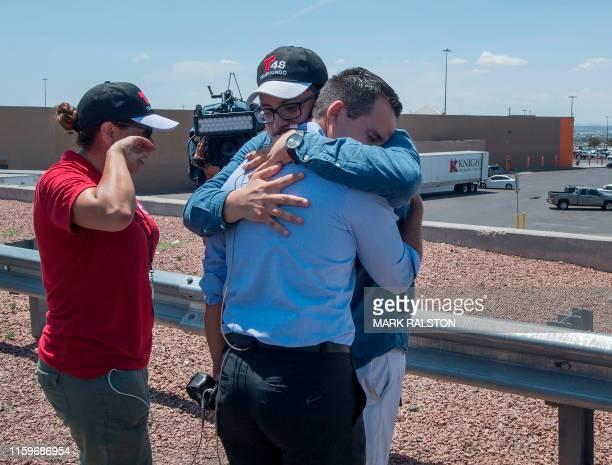A Telemundo reporter breaks down beside a makeshift memorial outside the Cielo Vista Mall WalMart where a shooting left 20 people dead in El Paso...