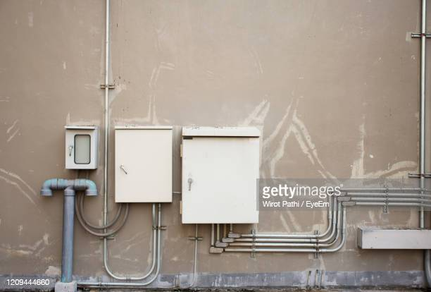 telephone booth against wall - electrical box stock pictures, royalty-free photos & images