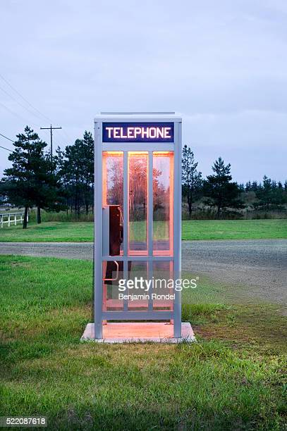 telephone booth by road - telephone booth stock pictures, royalty-free photos & images