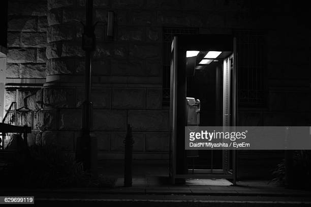 telephone booth by roadside - telephone booth stock pictures, royalty-free photos & images