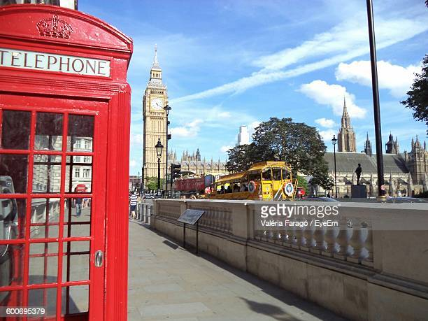 telephone booth in city with big ben against sky - telephone booth stock pictures, royalty-free photos & images