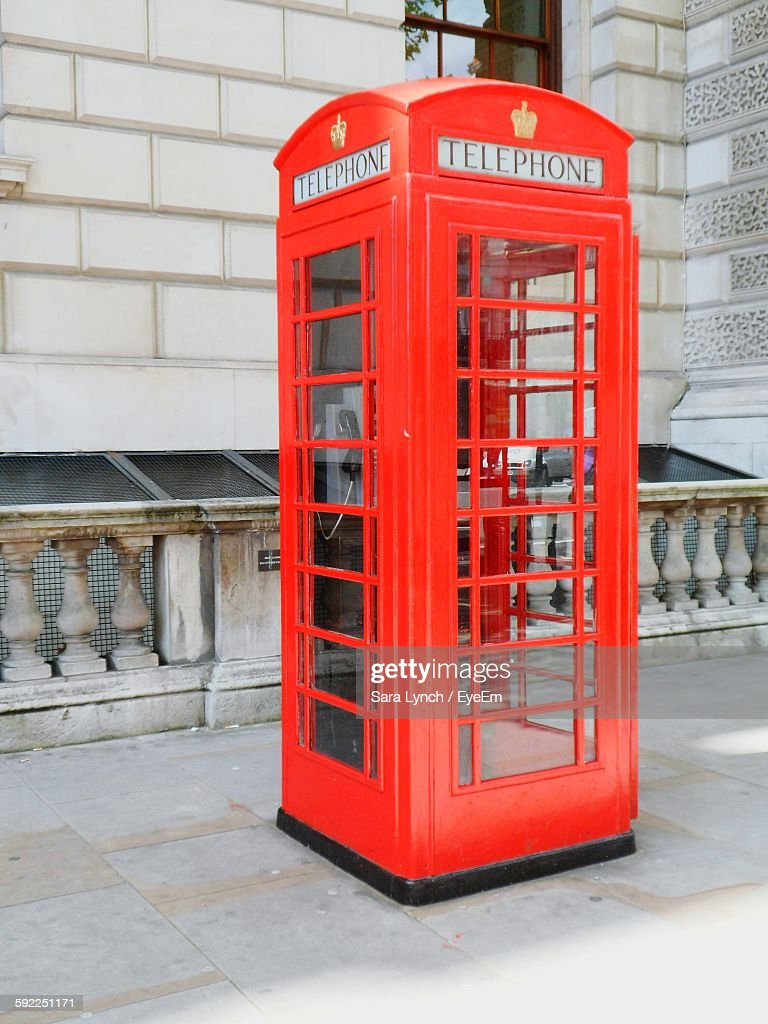 Telephone Booth On Footpath : Stock Photo