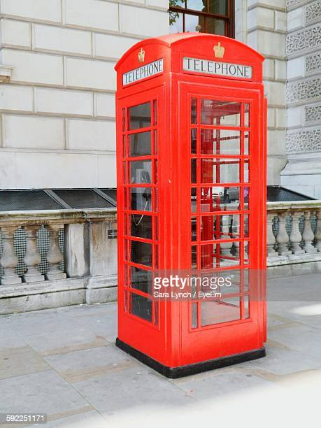 telephone booth on footpath - telephone booth stock pictures, royalty-free photos & images