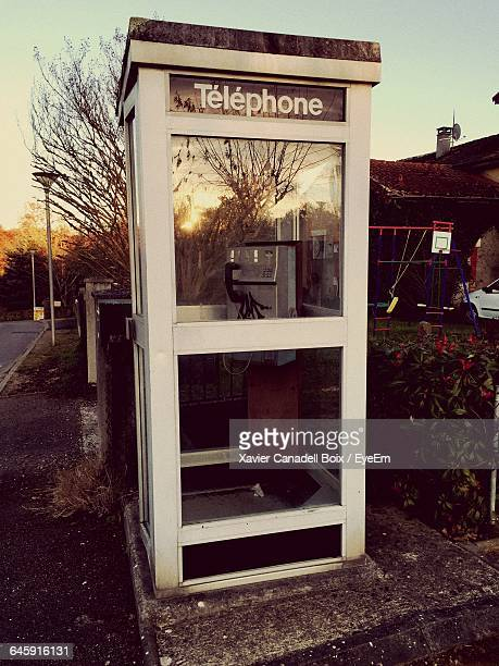 Telephone Booth On Roadside During Sunset