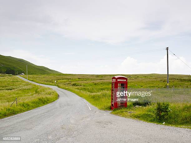 Telephone booth on side of country road