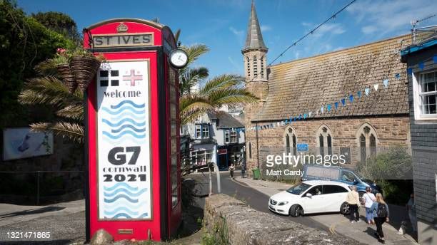 Telephone box is decorated with a welcome to G7 message at the popular tourist seaside town of St Ives, close to The Carbis Bay Estate hotel and...