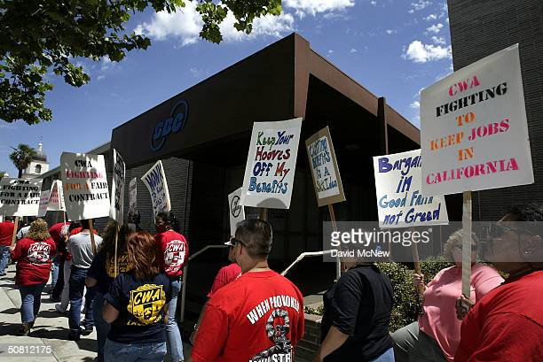 Telephone employees and members of the Communications Workers of America union picket in front of an SBC facility on May 7, 2004 in the Los Angeles...