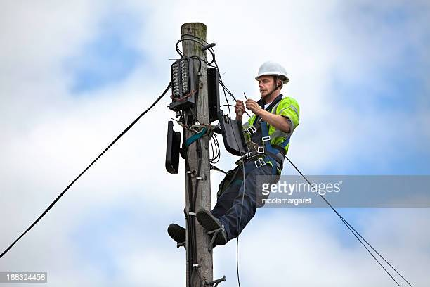 telephone engineer series - high up stock photos and pictures