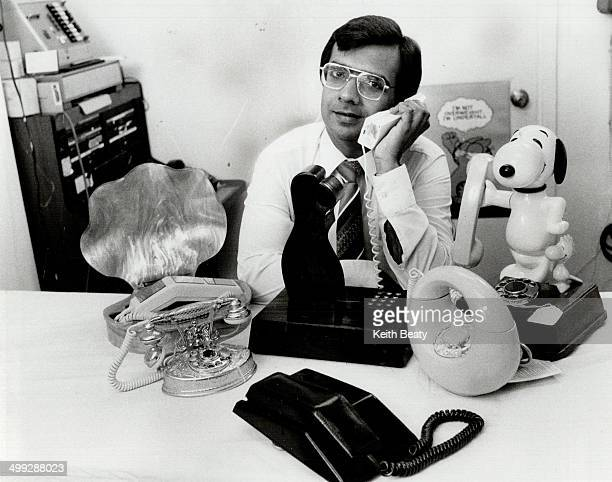 Telephone garden Mohan Samtani of World of Communications displays several weird and wonderful telephones including the Adam and Eve model