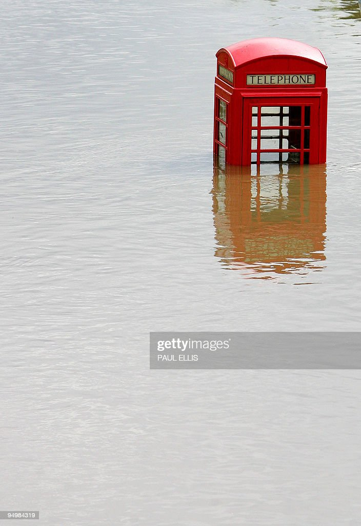 A telephone kiosk is seen in flood waters in the Catcliffe area of Sheffield, 26 June 2007 as the level of river water continued to rise across South Yorkshire. Hundreds of people in northern England were evacuated from their homes today after torrential rain that has so far claimed three lives threatened to cause a dam to burst. Prime Minister Tony Blair pledged support for those caught up in the widespread flooding, which also led to the collapse of a bridge in western England.
