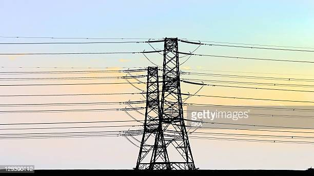 Telephone lines against blue sky