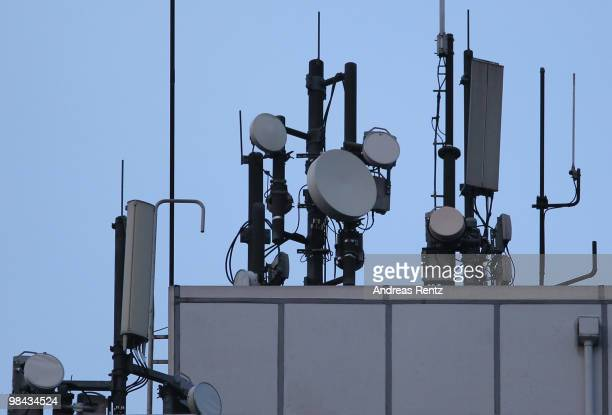 A telephone mast with multi antennas is seen on a building on April 13 2010 in Berlin Germany Deutsche Telekom Vodafone Telefonica's O2 and KPN are...