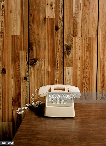 Telephone on wooden table