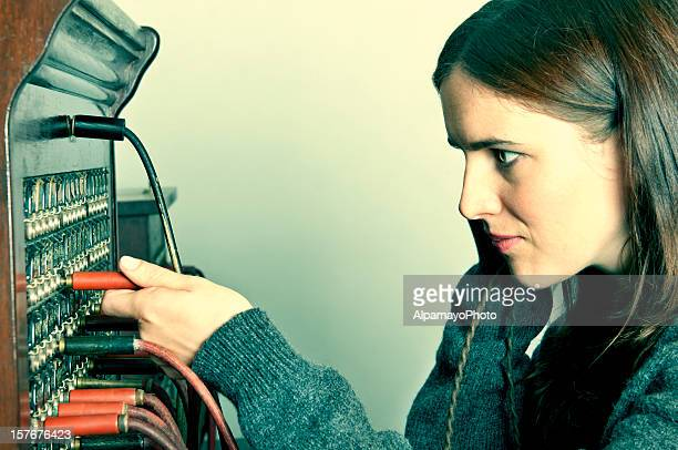 Telephone operator with outdated tele-communication technology (retro) - I
