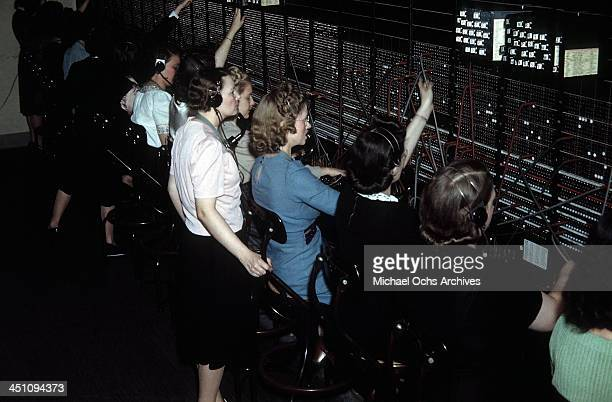 Telephone operators work the switch board in The Plaza Hotel in New York New York
