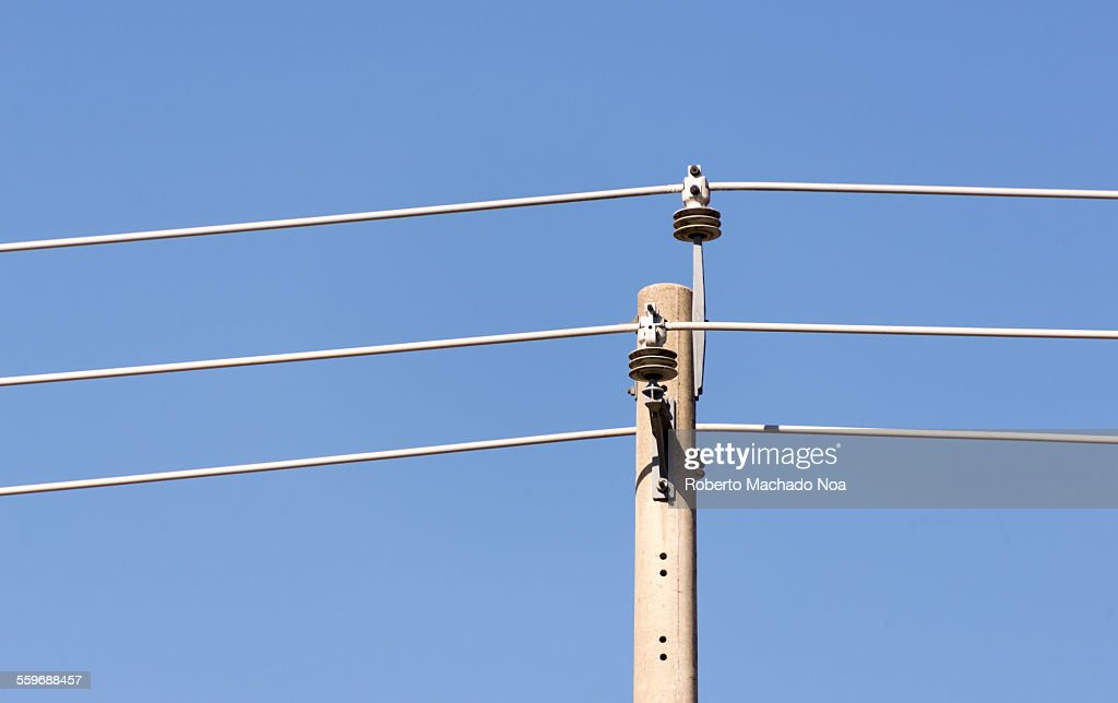 Telephone Pole And Wires In Front Of Blue Sky Stock Photo | Getty Images