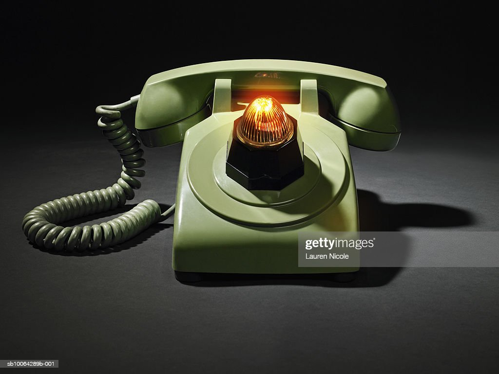 Telephone Ringing With Flashing Light Signal On Black Background Stock  Photo | Getty Images