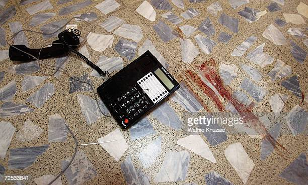 A telephone set is seen near smeared blood at an Iraqi Higher Education building where some 100 government employees and visitors were kidnapped on...