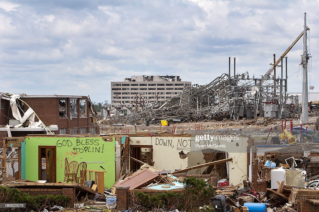 CONTENT] A telephoto shot near 2509 South Joplin Avenue in Joplin, Missouri gives a sense of the scale of devastation after a tornado. Is the distant background is the destroyed hospital.
