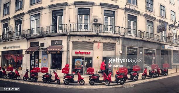 telepizza delivery mopeds parked outside the cafe, lisbon, portugal. - consegna a domicilio foto e immagini stock