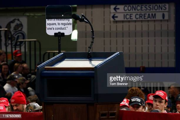 Teleprompter cycles through President Donald Trump's speech ahead of a campaign rally, inside the Knapp Center arena on January 30, 2020 in Des...